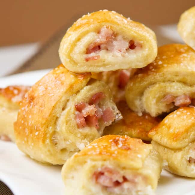 close up of a stack of pretzel bites with cheese and ham in the centers