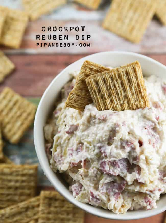 bowl of gooey dip with triscuits sticking out of it