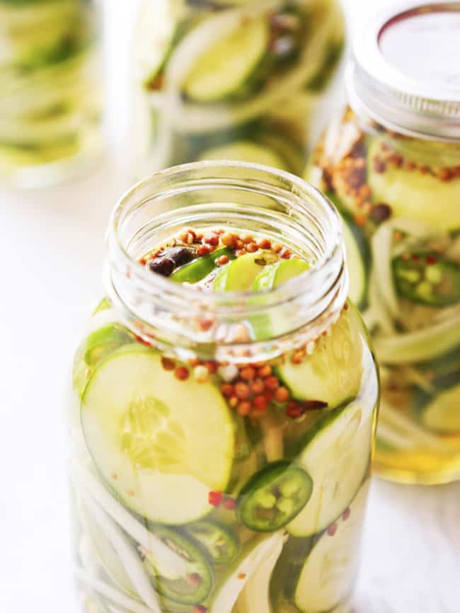sliced pickles in a large mason jar
