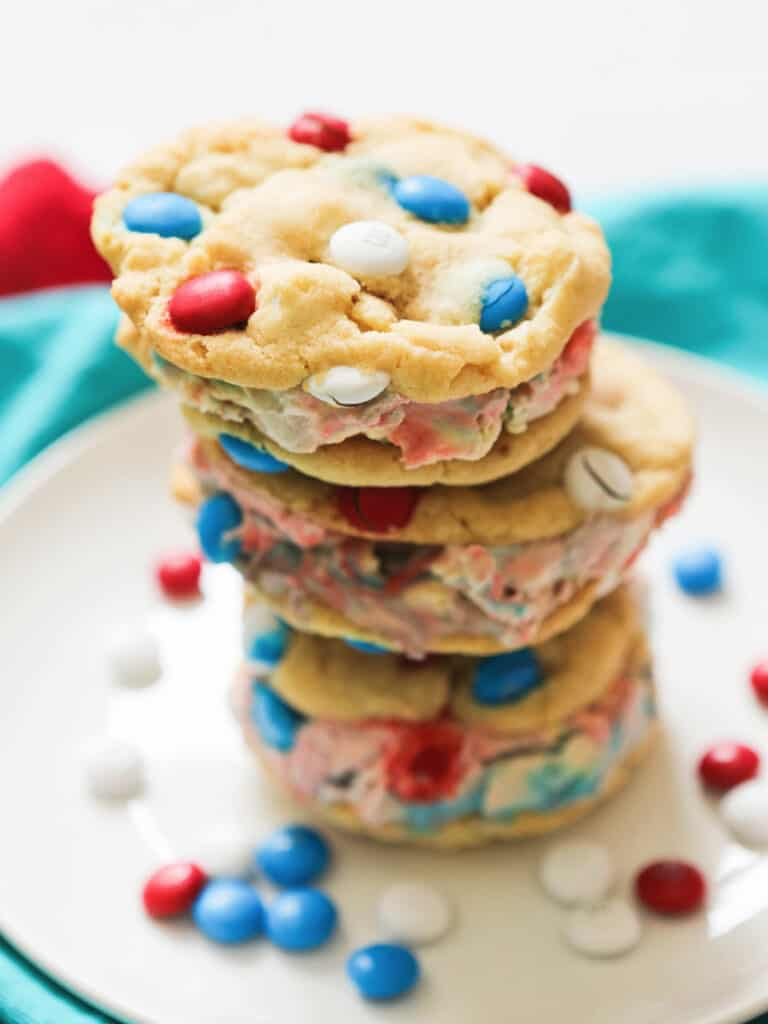 stack of ice cream sandwiches made with M&M cookies