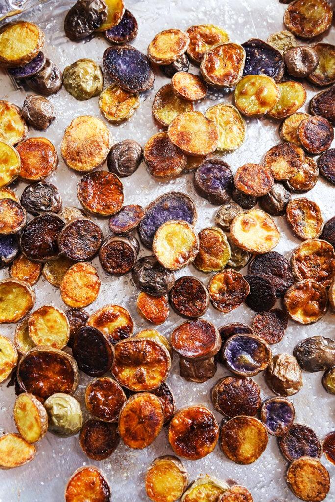 Baking sheet of salted  baked potato chips.
