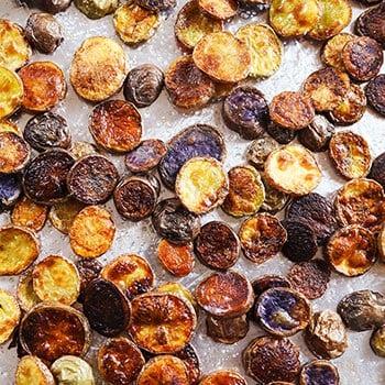 homemade potato chips on a baking sheet
