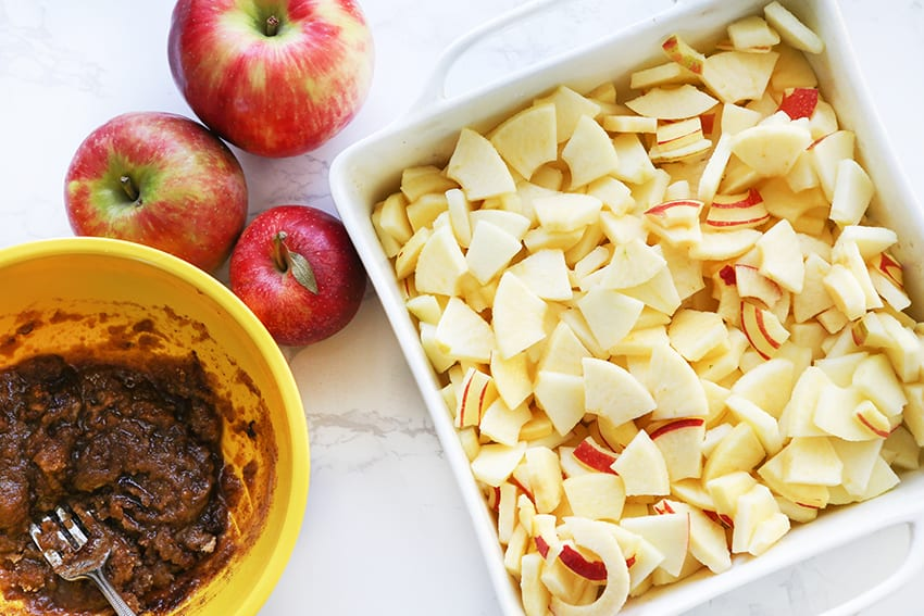 chopped apples in baking dish next to brown sugar mixture
