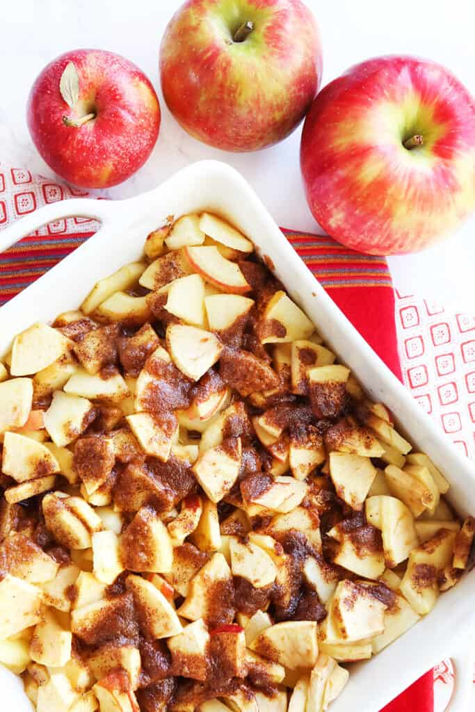 baked apples in pan next to 3 apples