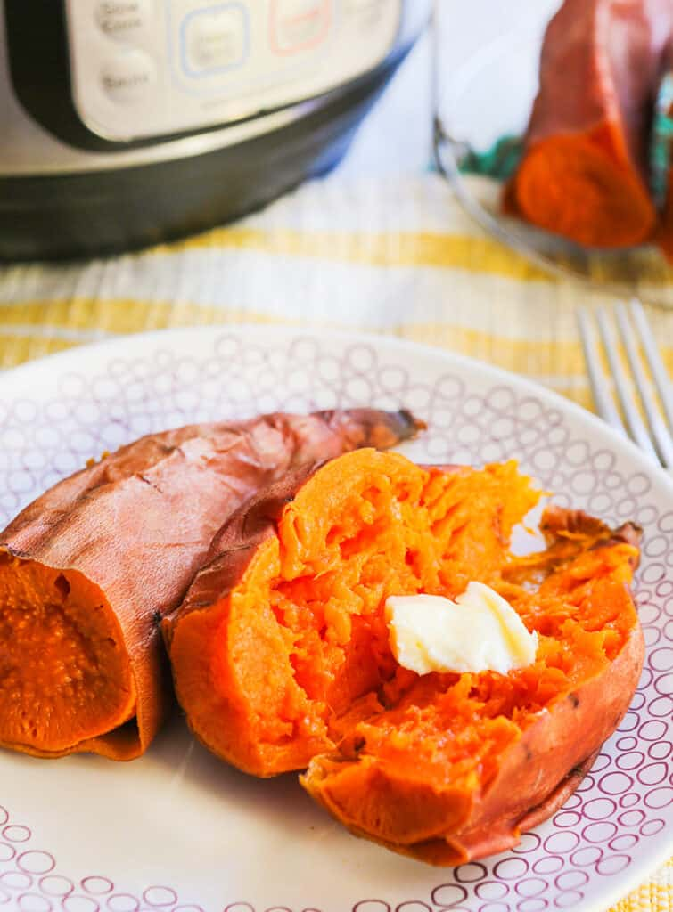 plate of a halved sweet potato with a melting pat of butter