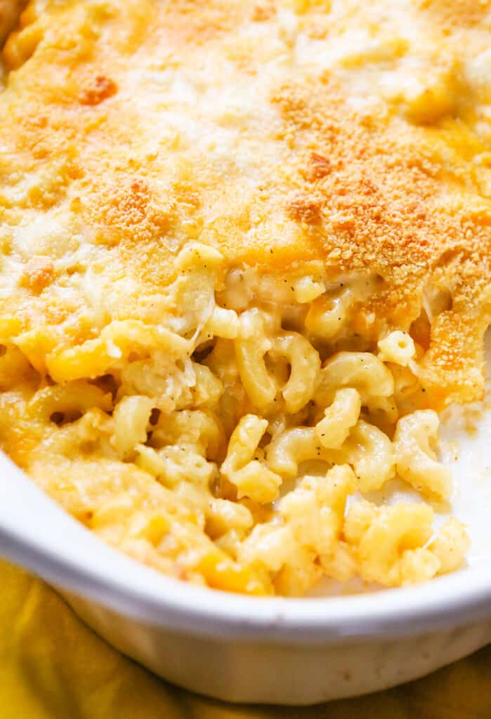 casserole dish of baked mac and cheese with a portion removed