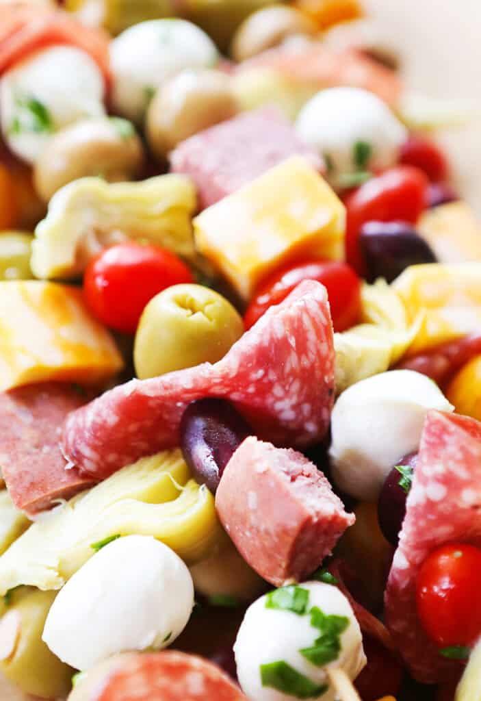 skewers with salami, olives, tomatoes and cheese