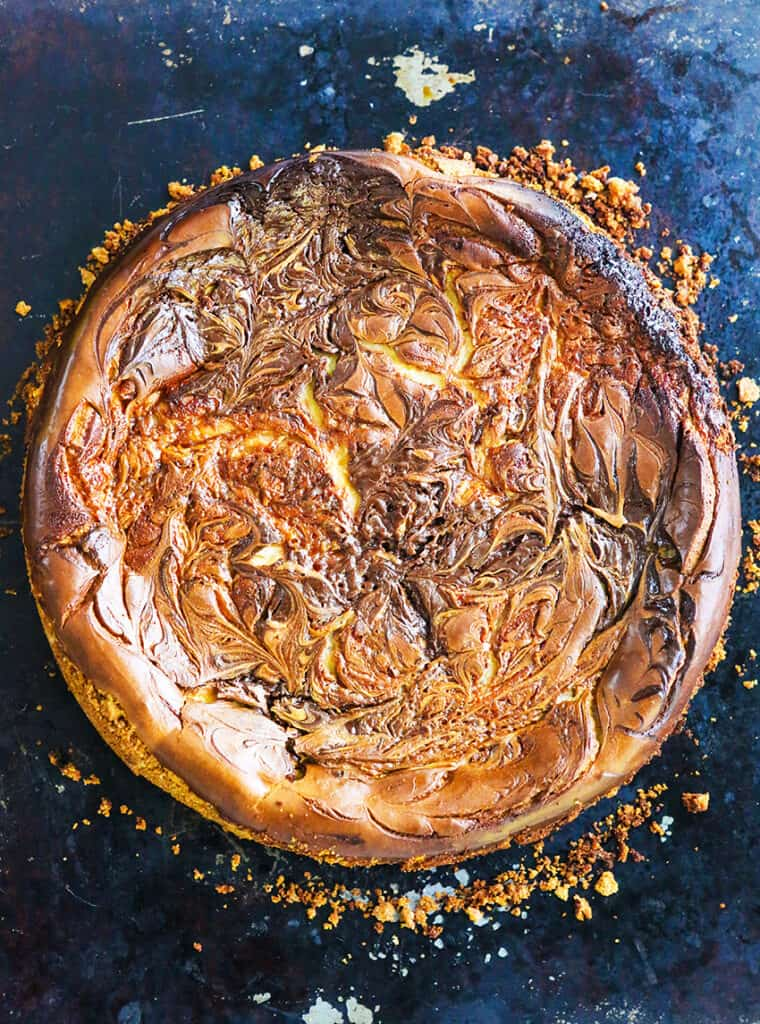top view of entire cheesecake, fudge and caramel swirls on top