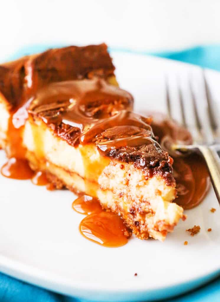 Perfect slice of cheesecake with caramel drizzled over the top