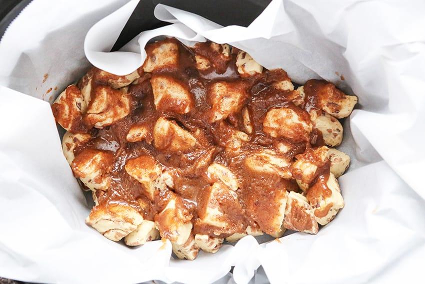 Sugar butter mixture spread over dough in crockpot