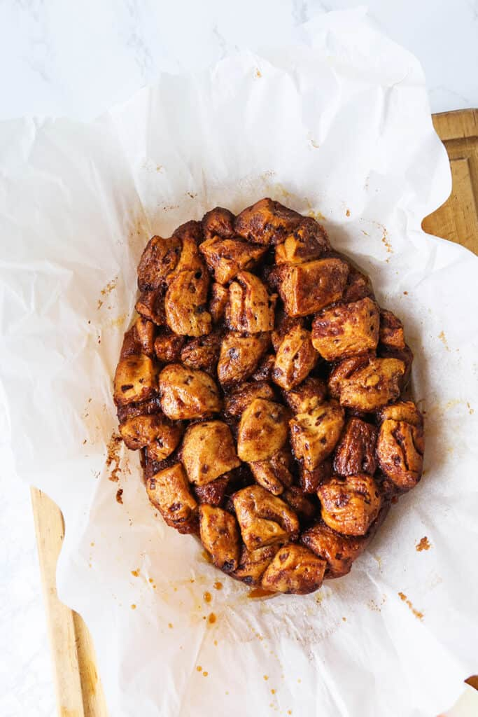 Cinnamon Roll Monkey Bread in parchment just out of slow cooker