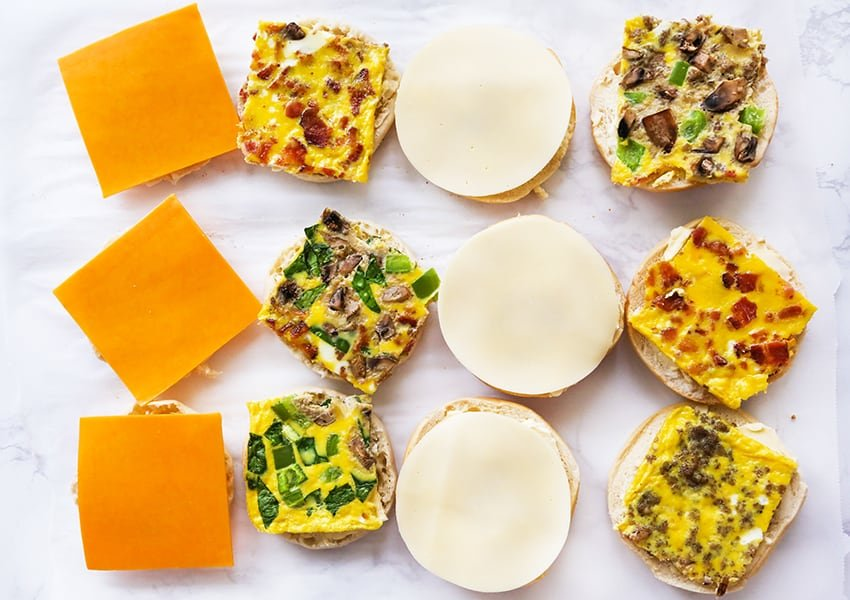 Freezer breakfast sandwiches on a flat surface and ready to be assembled