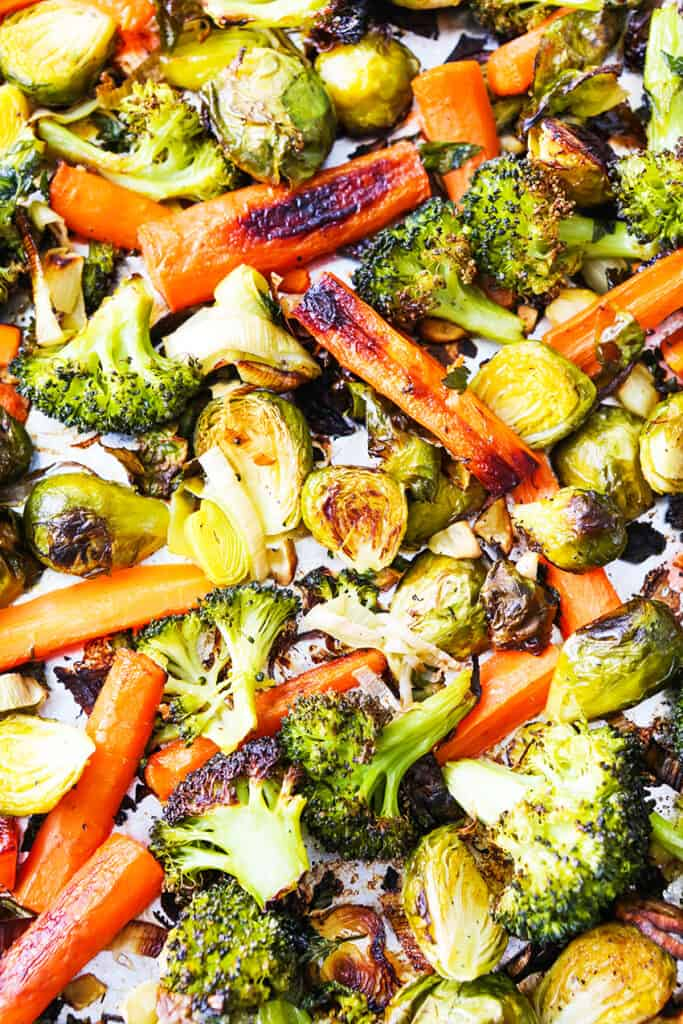 close up top view of sheet pan filled with roasted vegetables