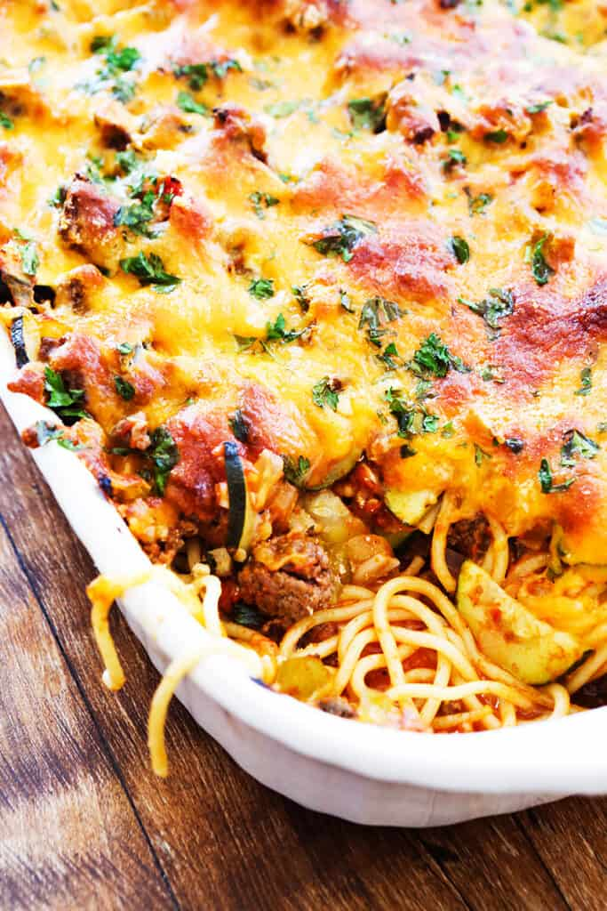 pan of baked spaghetti covered with a layer of cheese