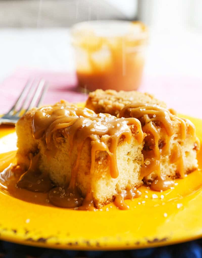 salted being sprinkled over caramel-covered breakfast pastry