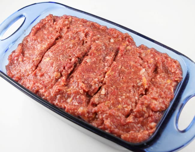 raw meatloaf mixture in a bread pan