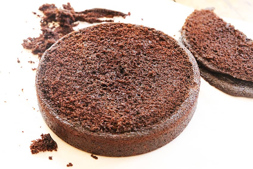 a round chocolate cake with the top removed