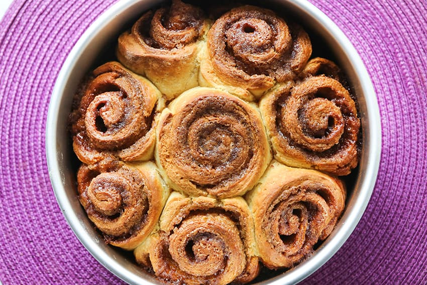 top view of cinnamon rolls in pan after baking