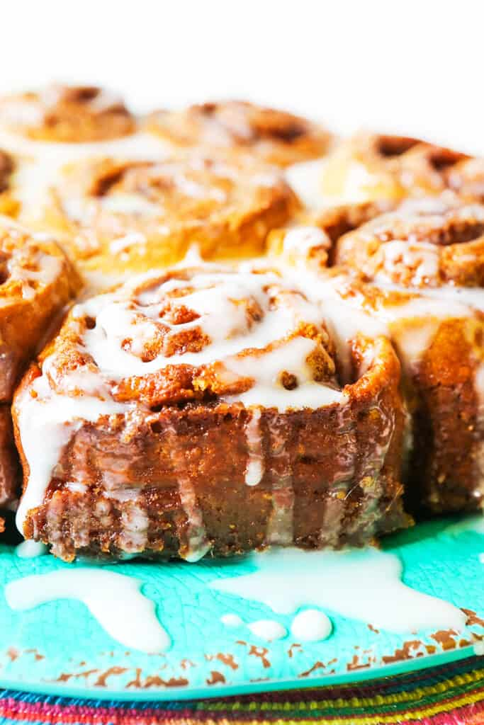 perfect plate of cinnamon rolls with glaze dripping off edges