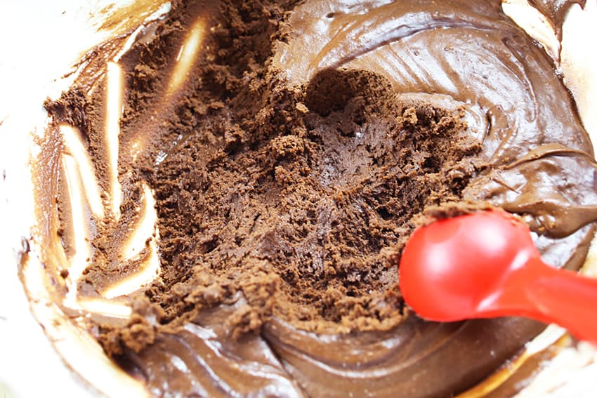 tablespoon sitting in a chocolate mixture