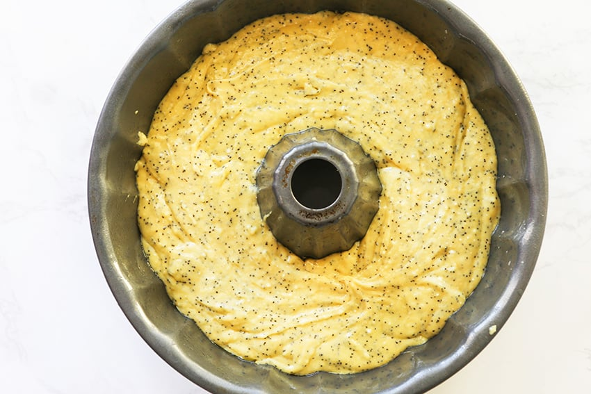 poppy seed cake mix in bundt pan before baking