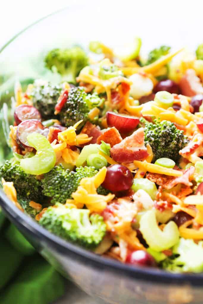 bowl of broccoli salad with bacon, celery and green onions