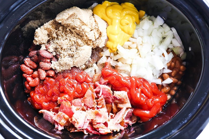 beans, ketchup, onions, mustard and bacon in a crockpot
