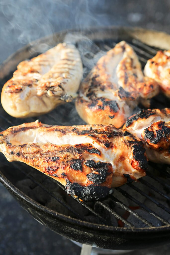 chicken breast on a grill, steaming
