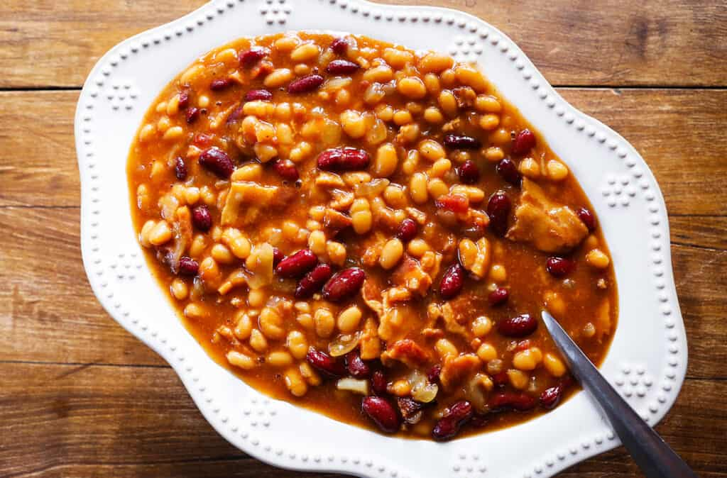 serving bowl filled with baked beans