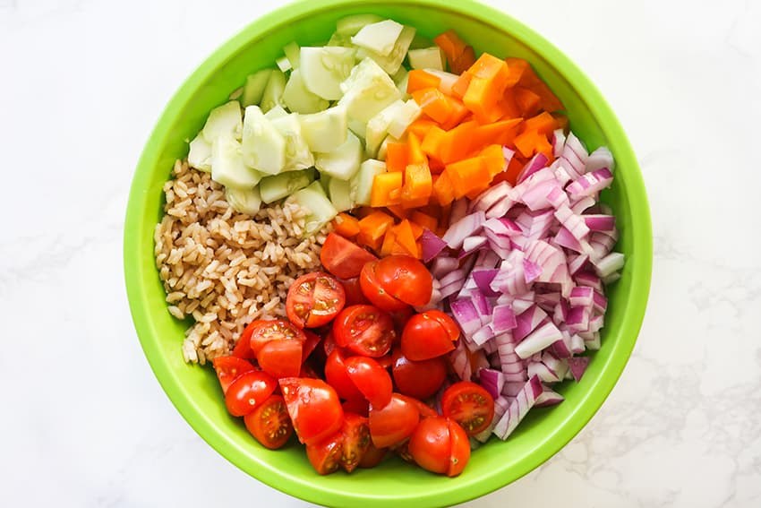 salad ingredients in bowl ready to be mixed