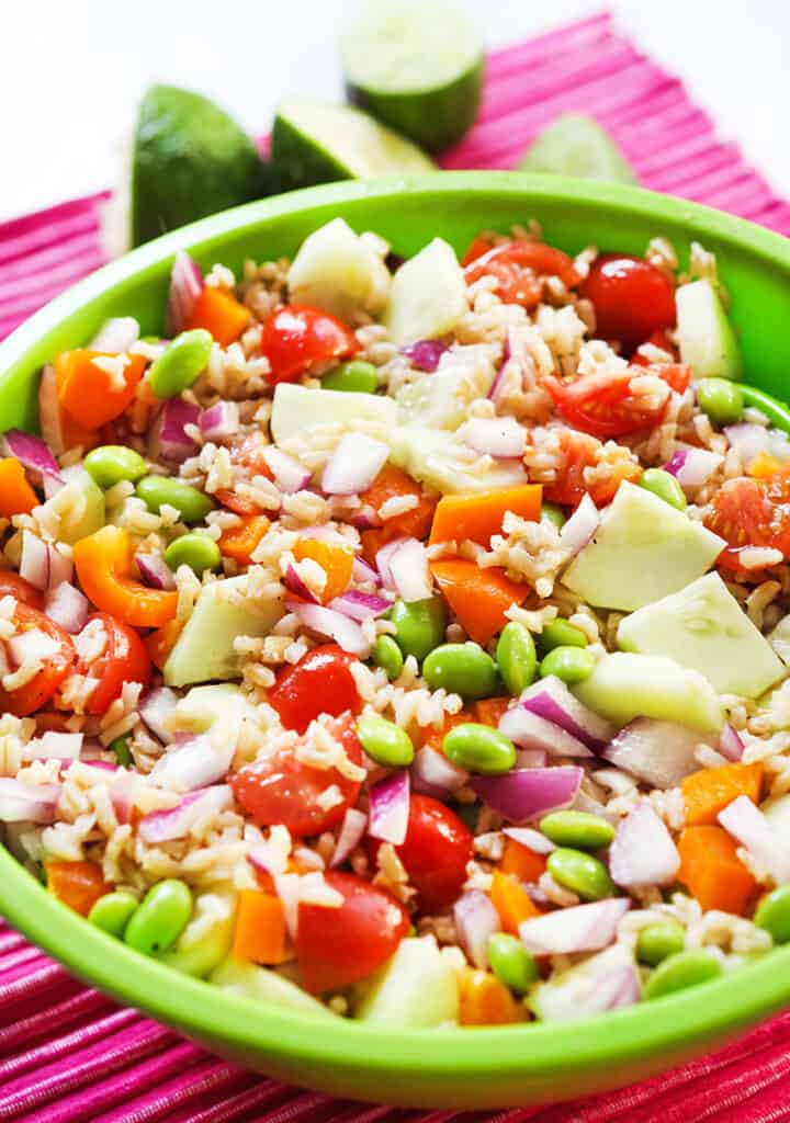 vegetable rice salad in a bowl on a pink placemat