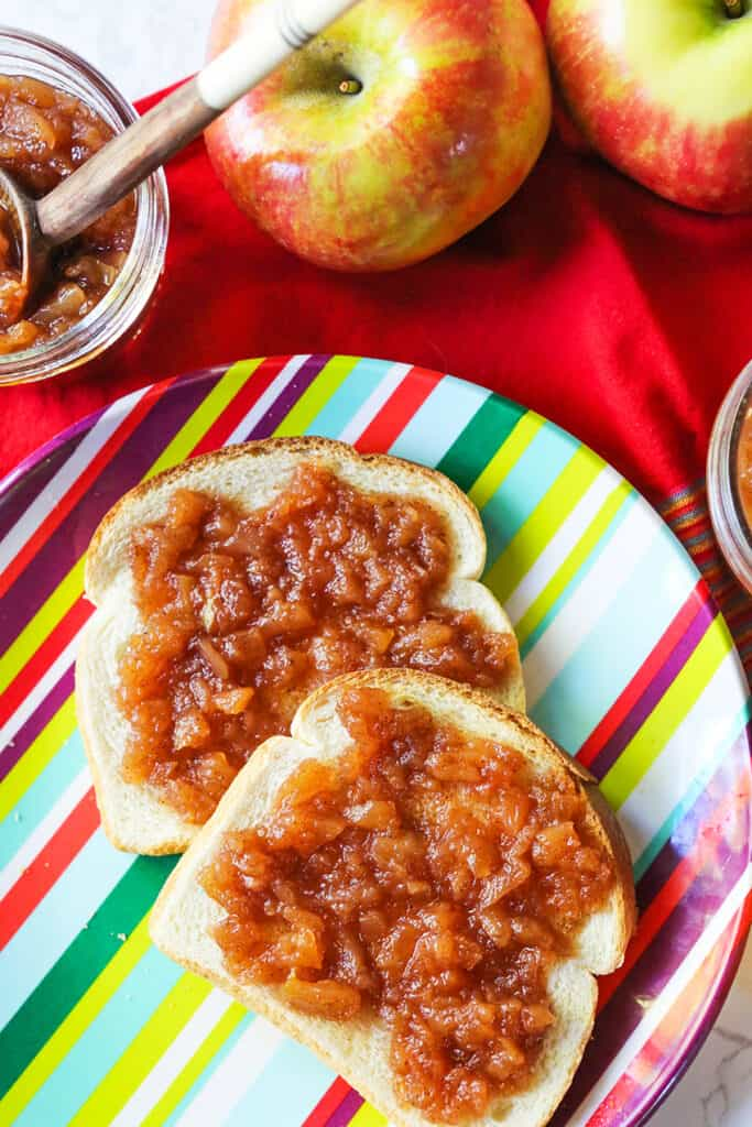 2 pieces of toast with apple butter spread over top