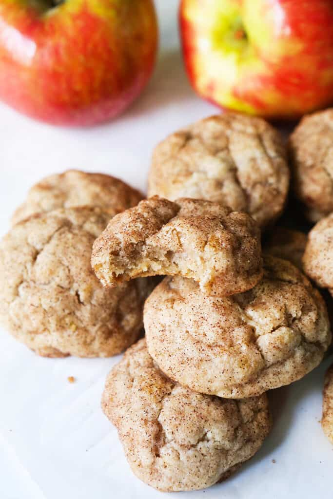 Pile of apple snickerdoodle cookies covered in sugar and cinnamon