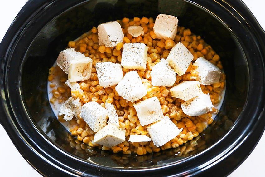 crockpot with frozen corn and cream cheese pieces