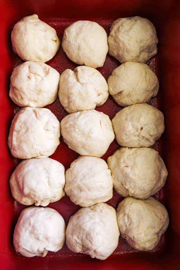 dough balls in baking pan