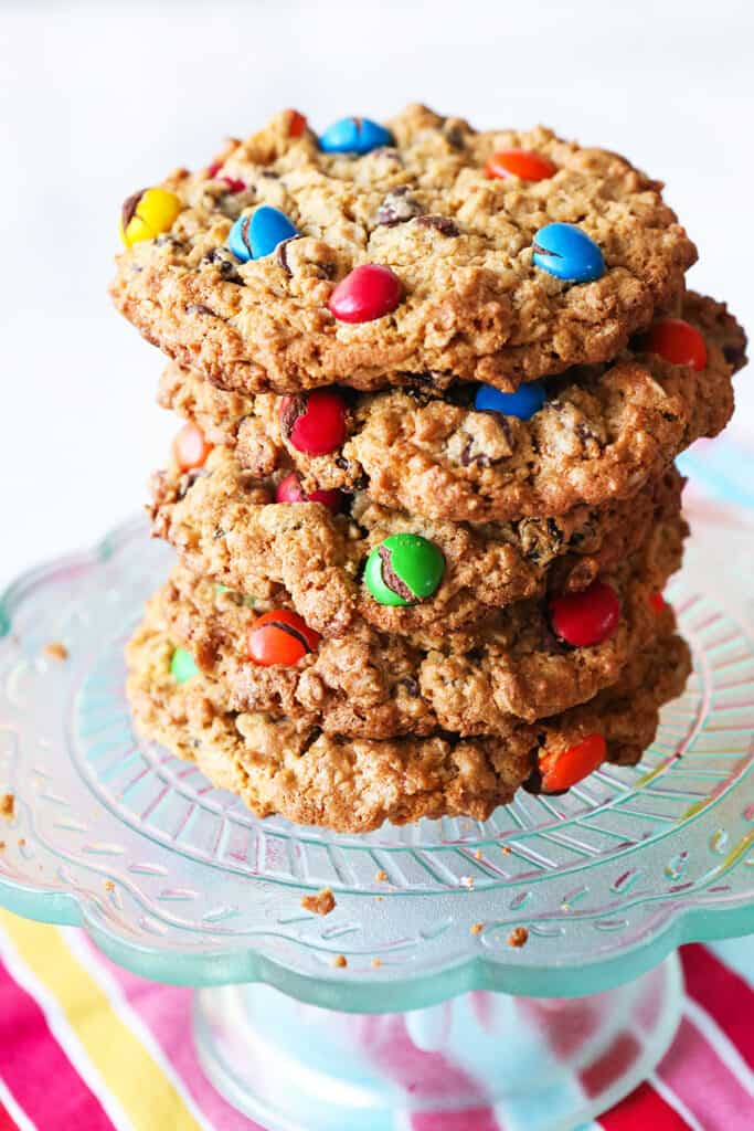 huge stack of monster cookies on a serving plate