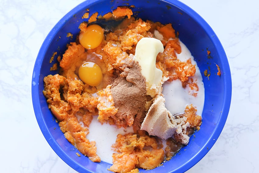 mashed sweet potatoes and other ingredients in a mixing bowl