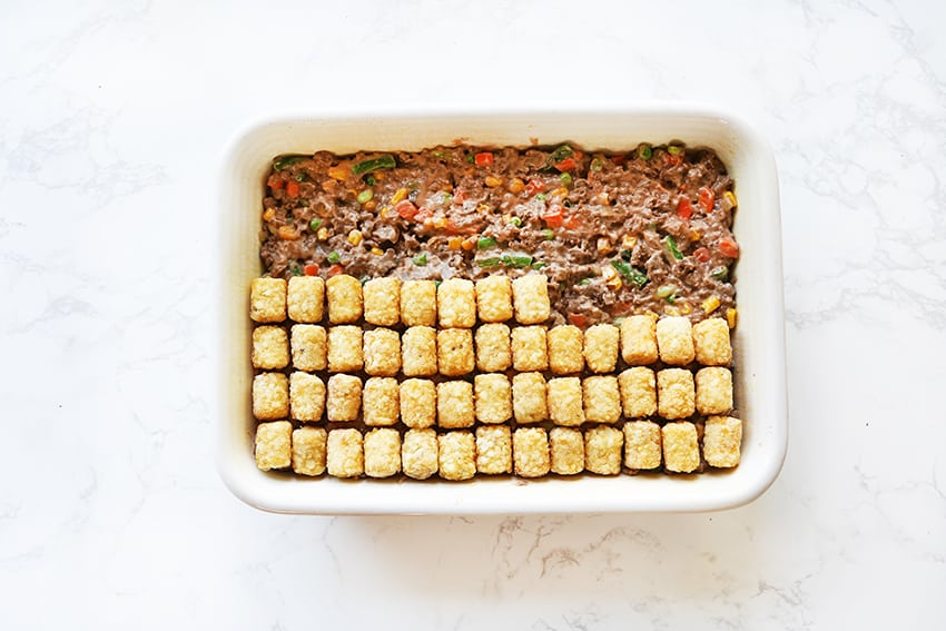 half the casserole covered with tater tots