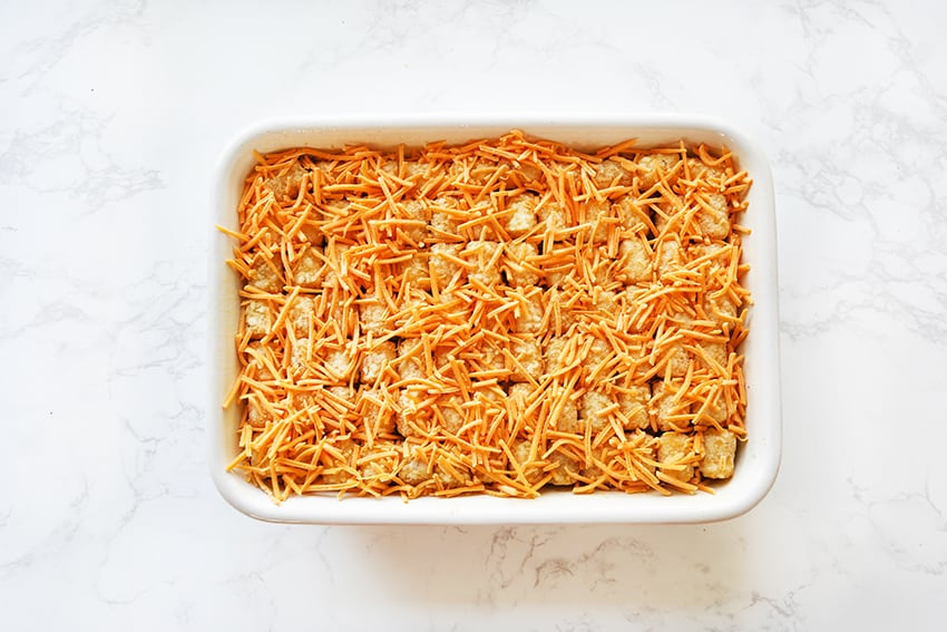 cheese-topped tater tot casserole ready for the oven
