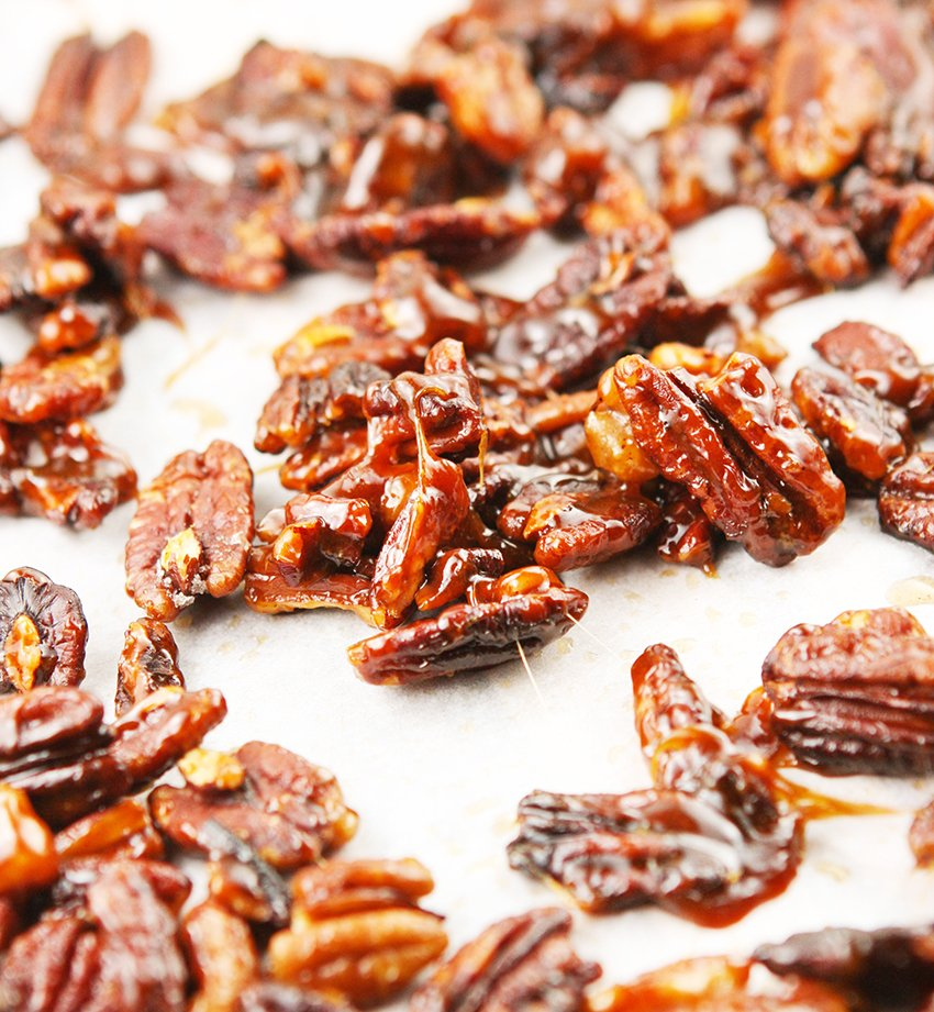 sticky stove top candied pecans on parchment paper
