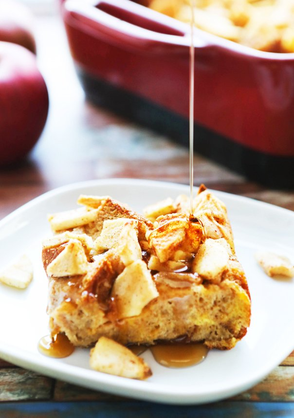 Syrup drizzling over a slice of apple french toast bake