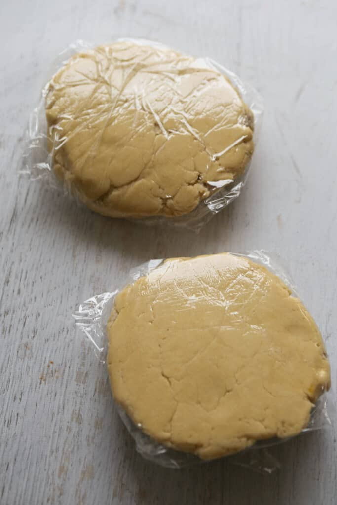 dough discs wrapped in plastic wrap