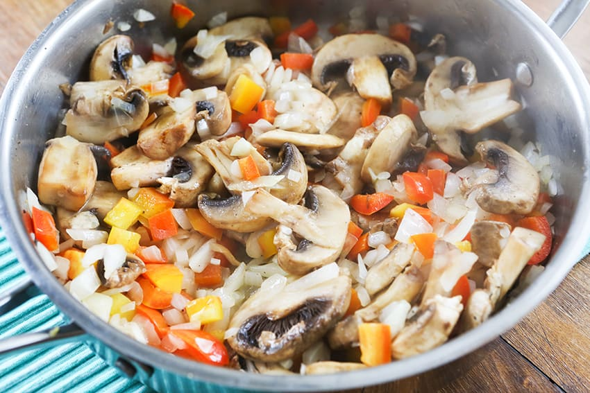 mushrooms, peppers and onions in a skillet