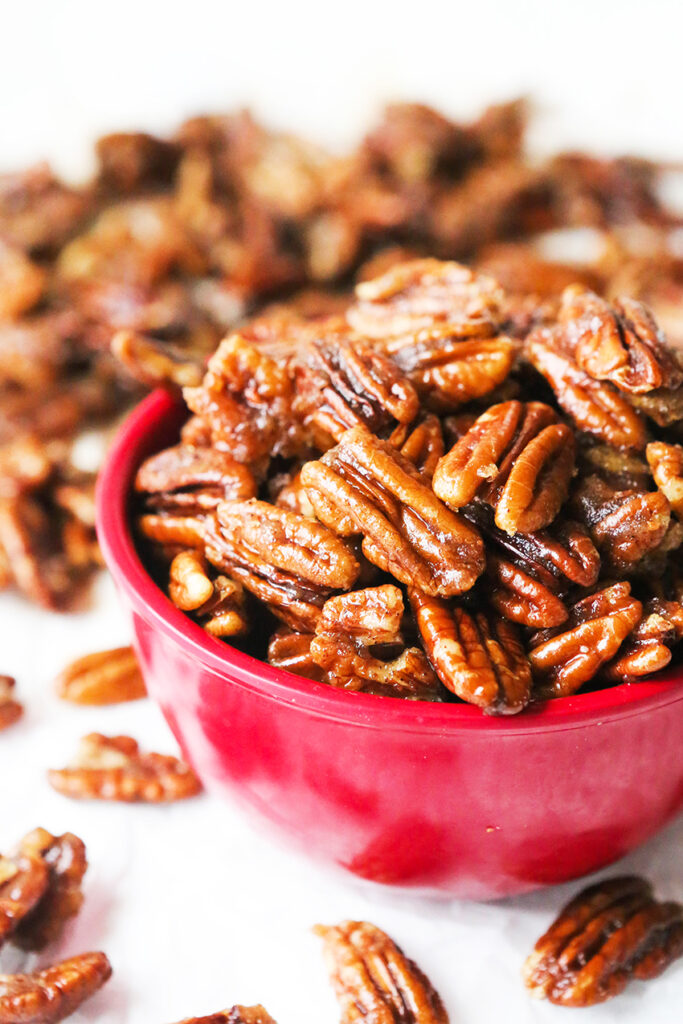 red bowl filled with sugared pecans