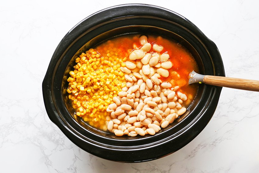white beans, corn and broth in a slow cooker
