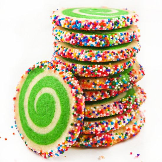 stack of colorfully sprinkled green and white cookies