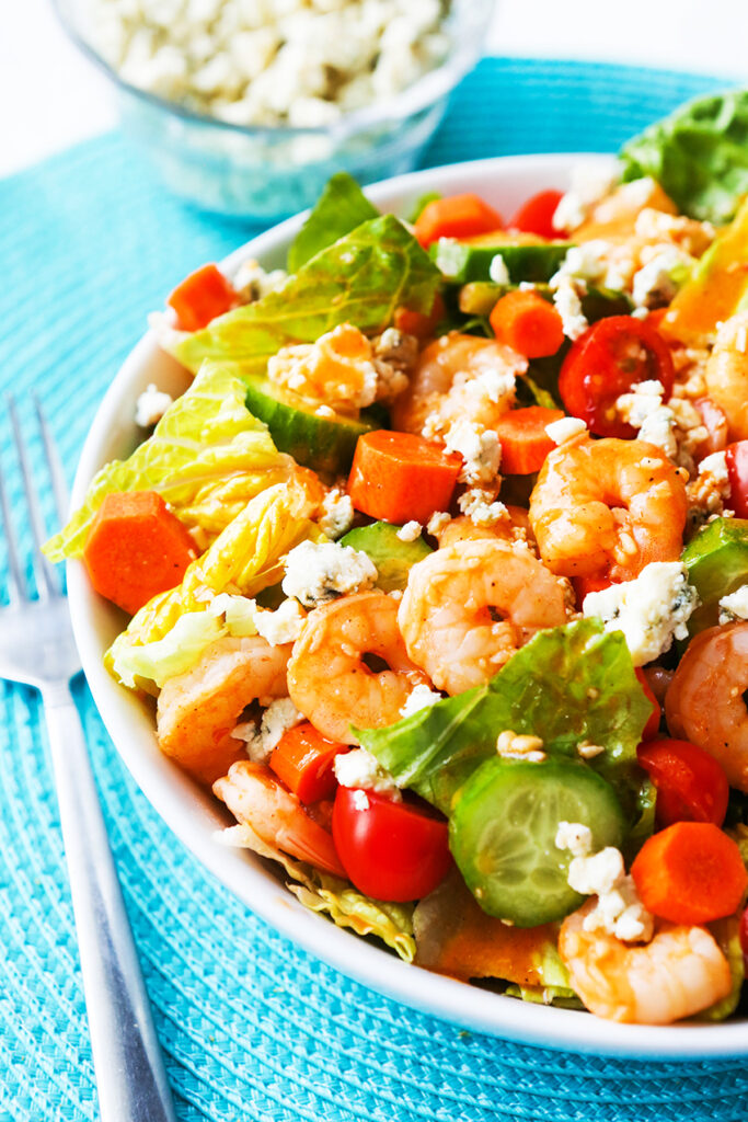 buffalo shrimp salad with blue cheese crumbles