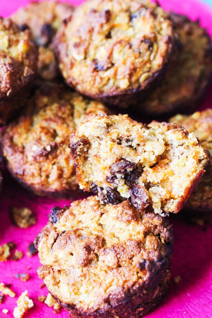 healthy breakfast muffins stacked on a pink serving plate