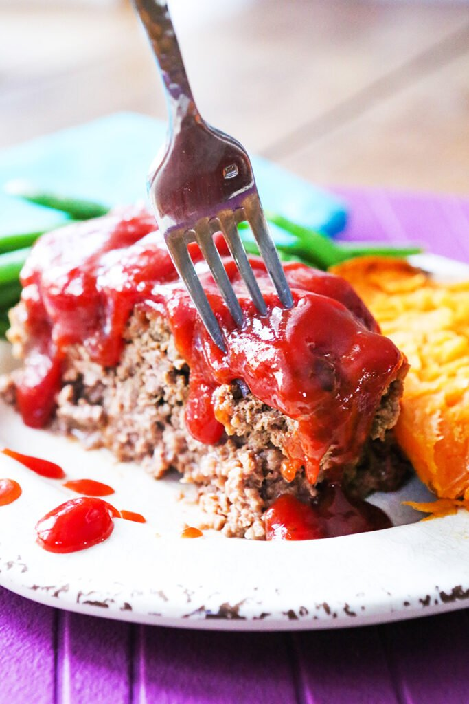 fork sticking in to take a bite of meatloaf recipe