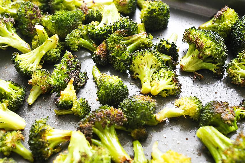 roasted broccoli on a baking sheet